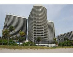 Positioned at the ultimate address in an exclusive beachfront enclave,