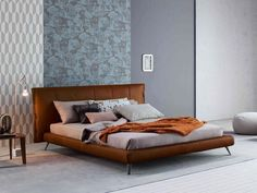 The Cuff bed expresses its strong personality in the tailoring details; from the frog fastenings that adorn the two flaps which cover the padded headboard, to the pleating that marks the vertical pattern of the back panel cover. The upholstery of the Cuff headboard can come with leather or fabric Read More