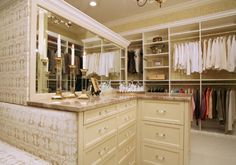 A lush and stocked walk in closet & a staff to keep it organized.
