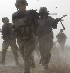 Pier Paolo Cito    During a firefight with insurgents in the Badula Qulp area, West of Lashkar Gah in Helmand province, southern Afghanistan    The area is near Marjah, where U.S. Marines are conducting an offensive against the Taliban