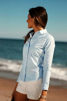 White shorts, light blue button-up collar blouse. Simple, classic, style, beach fashion