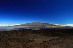 Mauna Kea is a volcano on the island of Hawaii. Standing 4,205 m (13,796 ft) above sea level, its peak is the highest point in the state of Hawaii. However, much of the mountain is below sea level; when measured from its oceanic base, Mauna Kea stands at more than 10,200 m (33,500 ft), significantly taller than the elevation of Mount Everest.
