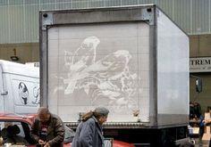 Beautiful reverse graffiti by Ben Long on dirty commercial trucks