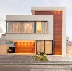 Fachada de casa com painéis de madeira que camuflam as portas de entrada! Modern House Facades, Modern Architecture House, Modern House Plans, Architecture Design, Residential Architecture, Duplex House Design, House Front Design, Small House Design, Modern House Design
