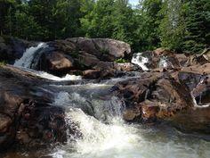 50 Michigan sights to see. Yellow Dog Falls in Michigan's Upper Peninsula.