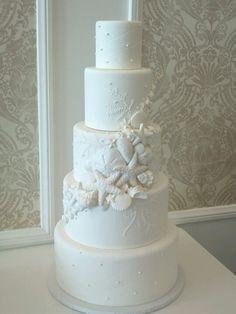 Sea shells themed wedding cake