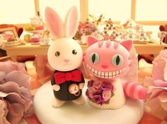 """hi, i'm calling to order a cake topper for my wedding...""  ""sure!  what're you looking for?""  ""oh, you know... nothing too out of the ordinary.  just a white rabbit dressed as a priest with a red bowtie and then - duh - a scary pink kitty with a bouquet of purple roses.  got it?"""