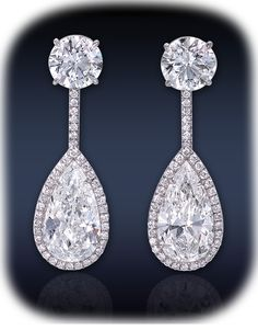 Jacob & Co.This Elegant Set Of Earrings Consists Of 2 Perfectly Matched GIA Certified 2.02-2.01 Ct. SI2 Clarity, G Color, Pear Shape Diamonds & 2 GIA Certified 1.01 VS2 Clarity, G Color, Round Brilliant Cut Diamonds, Highlighted By 0.30 Ct. White Diamonds Set In A Delicate Pave' Setting Mounted In Platinum.