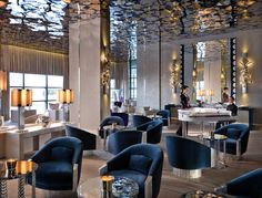 Jumeirah Bilgah Beach Hotel - Piano Lounge Love the ceiling treatment and the pop of color in the blue chairs
