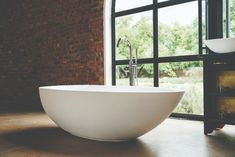 The elaine is an elegantly thick rimmed bathtub. It's spacious, with a unique and striking egg shape that brings character and luxury to your bathroom. Egg Shape, Modern Bathroom, Bathtub, Elegant, Luxury, Zen, Space, Unique, Standing Bath