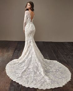 Fitted, lace, long sleeve wedding dress with a long train and low back. From the 2018 Badgley Mischka collection. Now available at Mariee Bridal in Scottsdale. Lacy Wedding Dresses, Designer Wedding Dresses, Bridal Dresses, Wedding Gowns, Country Wedding Dresses, Bridal Gown, Mod Wedding, Lace Wedding, Badgley Mischka Bridal