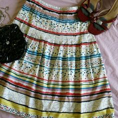 """Kay Unger Multicolor Pleated Skater Skirt Only worn a couple times. Side zip hook closure.  Pleating at top, with lots of fun prints. Perfect for your summer wardrobe. Waist 13 """" Length 23 """" Kay Unger Skirts Circle & Skater"""