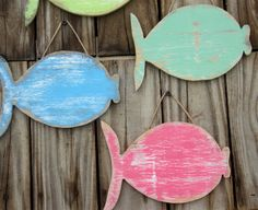 Hey, I found this really awesome Etsy listing at http://www.etsy.com/listing/154326633/school-of-3-wooden-fish-beach-y-cottage