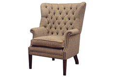 "Tetrad | Mackenzie Chair, Bracken | An ideal seat for the library or living room, this stately chair is built with a deep pocket-spring seat and feather-filled cushions with a generously buttoned, webbed back. It is upholstered in handmade ""Bracken Herringbone"" Harris Tweed with a trim of full-grain leather 