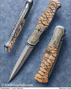 Fine fancy dagger by superb craftsman Larry Newton. Hot blues Thomas Damascus, exceptional Tiger Coral scales and all engraving by… Damascus Knife, Damascus Steel, Hot Blue, Knife Art, Metal Engraving, Knives And Swords, Folding Knives, Larry, Craftsman