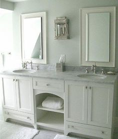 like the fresh white and chrome and the open shelves on the vanity and the concealed toe kick with furniture look bottom legs
