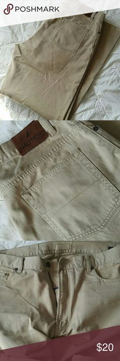 Nautica Mens Khaki Jeans 100% cotton mens 34wX34l khaki pants. Super soft and jean like structure, cut and material texture. In great shape with the slightest wear on the bottom back of legs. I haven't done any special treatment to the spots. Not noticeable unless inspected. Nautica Pants Chinos & Khakis