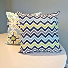 This listing is for two handmade decorative pillow shams of your size selection with navy, white, grey, lime green and light blue accents.