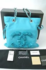 Brand New Authentic Chanel Drawstring Disc Tote Bag in Blue/ Turquoise