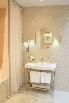 neutral and soft gold bathroom - look at that gold glass tile on the tub!