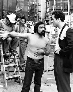 Martin Scorsese directs Robert De Niro behind the scenes on the set of Raging Bull (1980).