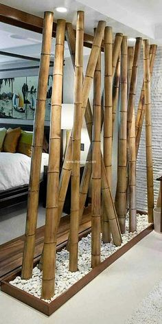 Bamboos are not only perfect for outdoors but they can also bring natural character to the indoor interior of your house. Bamboos can be awesome room dividers. They a re stylish yet natural in character. Here bamboos are digged in white pebbles which is giving the room quite natural feel.