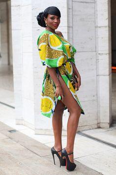 Sai Sankoh from Sierra Leone wears a Vivid Emporium dress and Christian Louboutin shoes