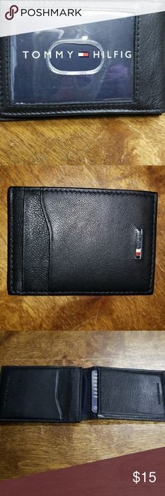 NEW!! Tommy Hilfiger Magnetic Wallet Black wallet with magnetic closure. Two slots for credit cards on front. Three slots for credit cards on inside. Slot for driver's license in front. New🎉  without box. Tommy Hilfiger Accessories