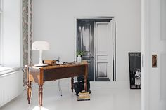 Black, white and cognac in a Swedish apartment