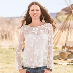 """ALABASTER PETALS BLOUSE--Our embellished floral silk blouse is a flowing, easy-fit statement of elegance, with flower and feather decorations and graceful scoop neck. Silk with polyester camisole. Dry clean. Imported. Exclusive. Sizes XS (2), S (4 to 6), M (8 to 10), L (12 to 14), XL (16). Approx. 25-1/2""""L."""