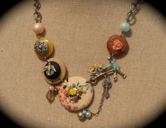 Cute...too bulky for me, but cute!  Flower cart necklace