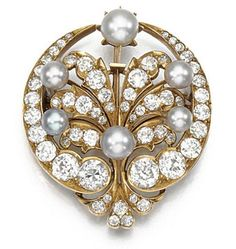 PEARL AND DIAMOND BROOCH, CIRCA 1890 Of stylised palmette and crescent design set with pearls of various sizes and tints, highlighted with circular-cut diamonds, pendant loop.