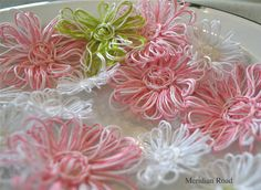 Add these cute twine flowers to  Easter or Mother's Day scrapbook page layout or a card. Tutorial on how to make the flowers http://www.youtube.com/watch?v=GgQRf0x836Q