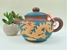 Chinese Yixing Clay Teapot Phoenix and Dragon Relief Moulded Knot Collectable
