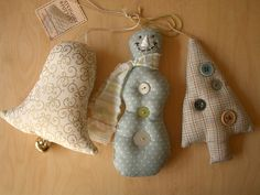 I have some of my Grandma's fabric Christmas ornaments similar to the bell.  I think I will try to make some this year :)
