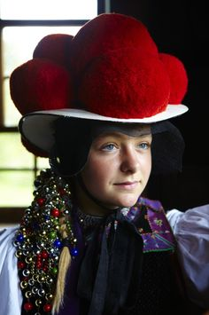 "Europe | Portrait of a girl wearing traditional clothes and pompom hat, a Bollenhut, Black Forest (German: ""Schwarzwald""), Baden-Württemberg, Germany #pompom #beads"