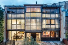 The glass bricks and expressed steel frame of Eglon House are intended as a reference to Maison de Verre in 1930s Paris.