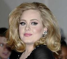 Adele :: She is the first woman in Billboard history to have three singles in the top ten chart simultaneously and two albums in the top five, and she is the first artist to have two top five hits on both singles and albums charts since the Beatles.