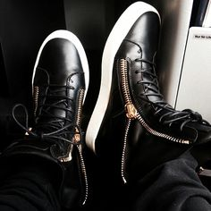 """Me and my Guiseppe Zanotti's getting ready to take off on the plane :)"" 02/27/2014"