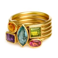 Colorful Bouquet $4,550 approx. £2,700 22K gold Colorful Bouquet 5 Rings - 1 - 22K gold marquise-cut ring set with Aquamarine 2 - 22K gold Princess-cut ring set with Peridot 3 - 22K gold emerald cut ring set with purple Amethyst 4 - 22K gold round ring set with Citrine 5 - 22K gold Oval ring set with Pink Tourmaline