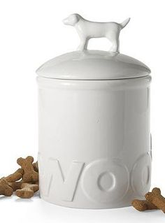 """Store your pet's favorite treats in style with the Woof Treat Jar that's embellished with raised ceramic letters that spell out """"woof""""."""