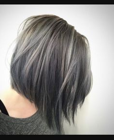 Gray hair transition highlights in a cute bob