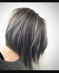 Gray hair transition highlights in a cute bob