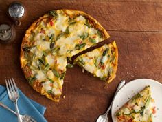 Giada adds a crisp bite and a touch of spring to her frittata with fresh asparagus spears. Cube, don't shred the cheese on top — you'll get big bursts of flavor when you bite into each melty pocket.