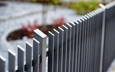Thin fence posts and beveled head elements characterize the purist style