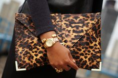 ASOS Clutch,  Jewelmint Bracelet, Michael Kors Watch,  YSL Arty Dots Ring   Would be nice with my Rossi