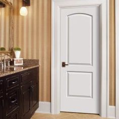 JELD-WEN Smooth 2-Panel Arch Top Solid Core Primed Molded Prehung Interior Door-THDJW137000611 at The Home Depot
