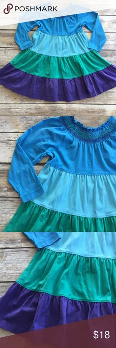 Hanna Andersson Twirl Dress Long sleeve Twirl dress with Smocked neckline. VGUC with minimal wash wear. Blue green and purple striped. Hanna Andersson Dresses