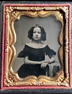 "Simply a solid ninth plate of a gorgeous young girl wearing her very best black off the shoulder dress, her several strand necklace and her hair beautifully set in the popular style known as ""Bottle Curls."". 