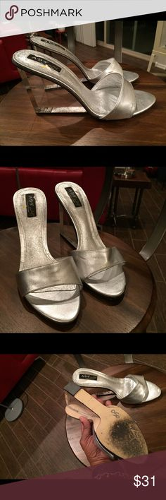 Sliver wedge with clear heel. Sexy. Gently, rocked. Private dance collection kind of sexy wedges.  Brand ABS Allen Schwartz•Out of stock.  Fall into the lap of luxury with this contemporary wedge slide on from ABS. A vivid silver leather upper is detailed with a unique 3 3/4 inch clear ... ABS Allen Schwartz Shoes Mules & Clogs
